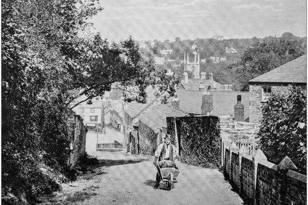 Old picture of man with wheelbarrow in Bodmin