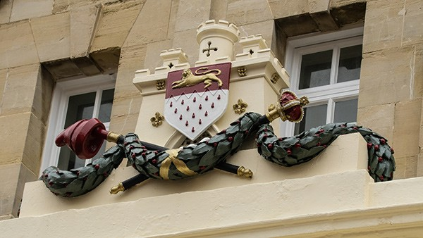 Chichester coat of arms on building