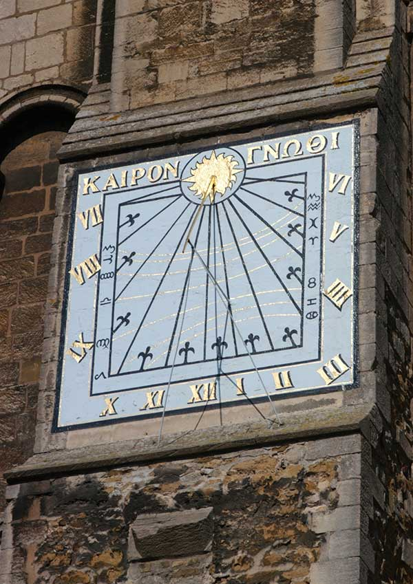 Sundial on the wall of Ely Cathedral