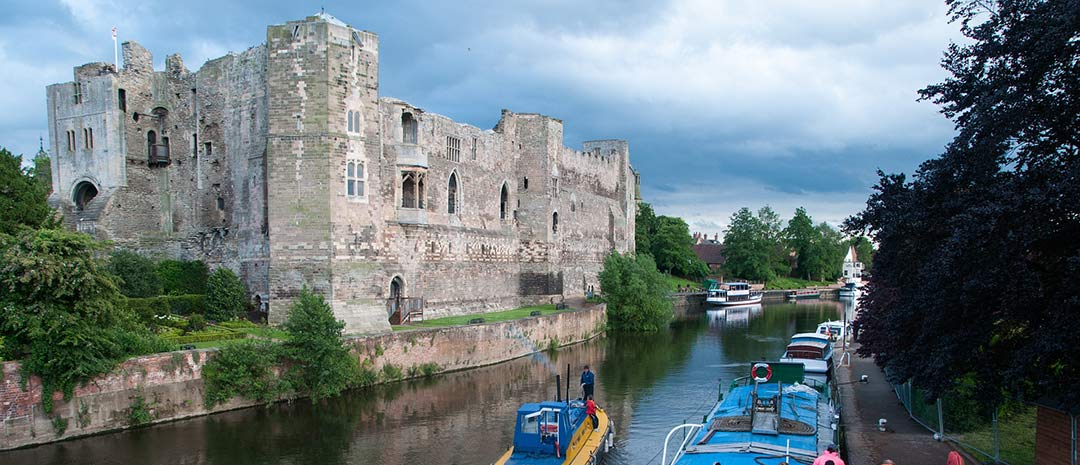 Leicester castle with canal boat in foreground