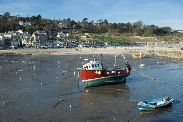 Boats on low tide at Lyme Regis
