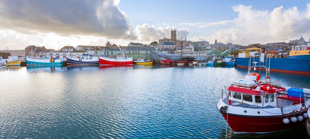 View across Penzance harbour with fishing boats