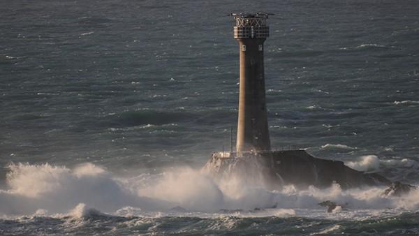 Penzance light house with waves crashing over it
