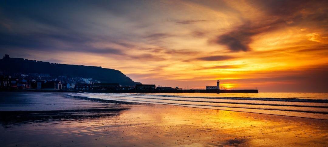 Scarborough south beach sunrise over lighthouse