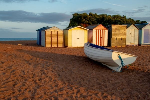 Teignmouth beach huts and boat