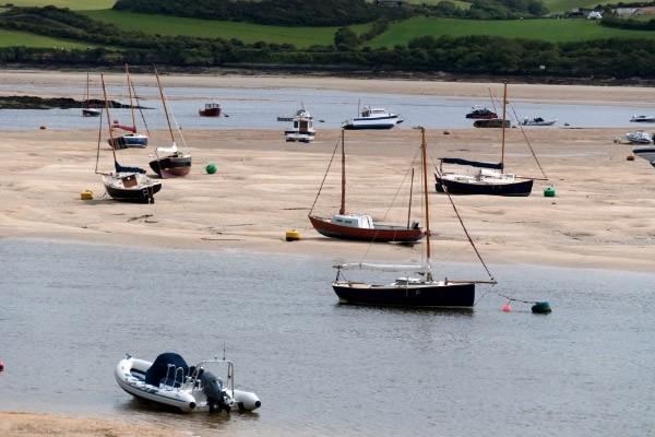 Boats at low tide on river camel wadebridge