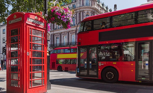 Red London bus and red telephon box in London Middlesex
